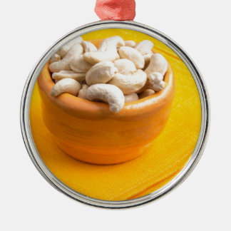 Selective focus on raw cashew nuts closeup Silver-Colored round ornament