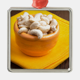 Selective focus on raw cashew nuts closeup Silver-Colored square ornament