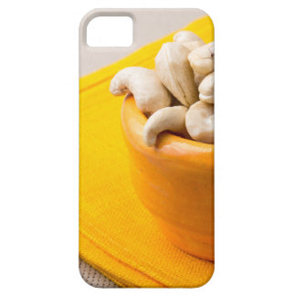 Selective focus on raw cashew nuts in a small cup iPhone 5 case