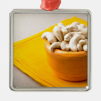 Selective focus on raw cashew nuts in a small cup Silver-Colored square ornament