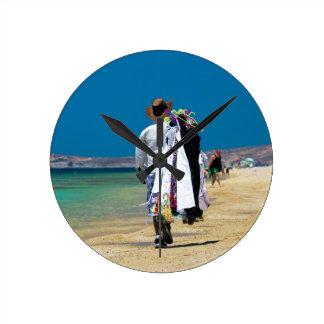 Seller on the beach round clock