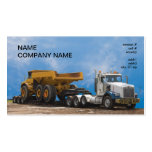 semi truck and trailer hauling a large dumptruck business card