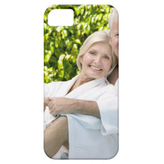 Senior Caucasian couple in robes in spa. iPhone 5 Covers