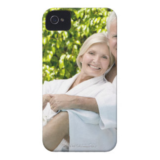 Senior Caucasian couple in robes in spa. iPhone 4 Cases