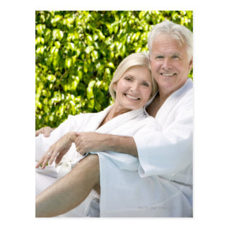 Senior Caucasian couple in robes in spa. Postcard