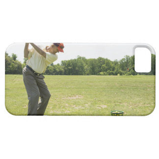 Senior golfer hitting practice balls at a range iPhone 5 covers