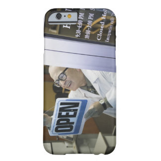 Senior male pharmacist hanging 'Open' sign in Barely There iPhone 6 Case