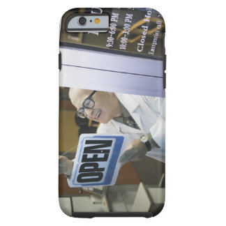 Senior male pharmacist hanging 'Open' sign in Tough iPhone 6 Case