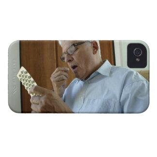 Senior man taking pill Case-Mate iPhone 4 case