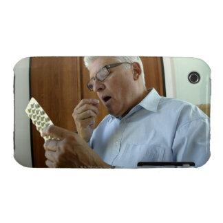 Senior man taking pill iPhone 3 cover