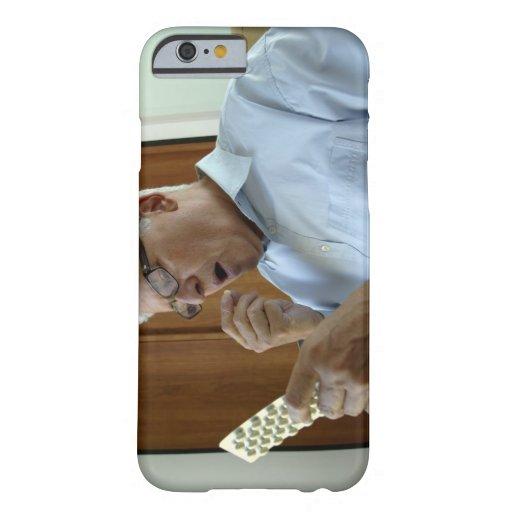 Senior man taking pill iPhone 6 case