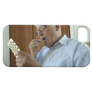 Senior man taking pill iPhone 5 cover