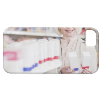 Senior woman comparing packages in drug store iPhone 5 cases