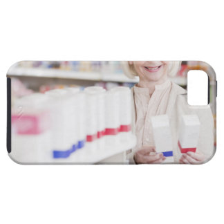 Senior woman comparing packages in drug store iPhone 5 covers