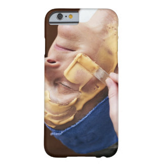 Senior woman having facial cream applied barely there iPhone 6 case