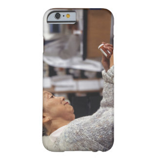 Senior woman in pharmacy reading medicine bottle barely there iPhone 6 case