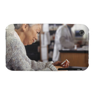 Senior woman in pharmacy reading medicine bottle Case-Mate iPhone 3 case