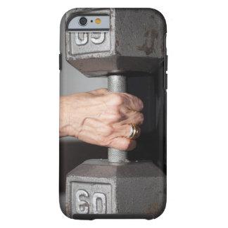 Senior woman lifting weights tough iPhone 6 case