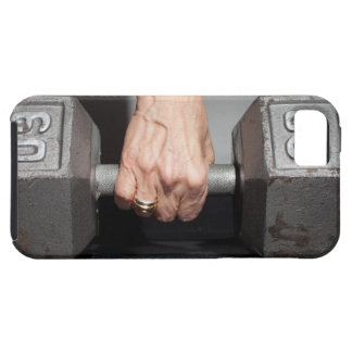 Senior woman lifting weights case for the iPhone 5