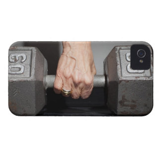 Senior woman lifting weights iPhone 4 cover