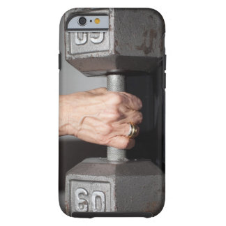 Senior woman lifting weights tough iPhone 6 case