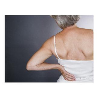 Senior woman with backache 2 postcard