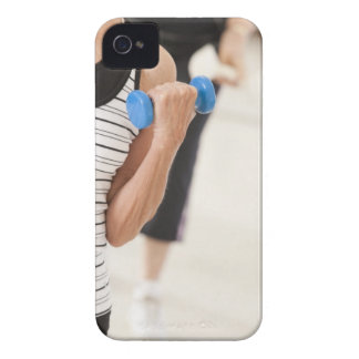 Seniors exercising with dumbbells in a health iPhone 4 Case-Mate cases