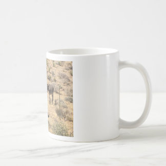 Separated by borders coffee mug