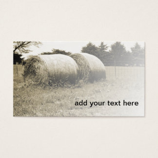 sepia image of two large round hay bales business card