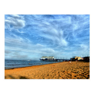 Serene Bright Beach With Pier & Marbled Clouds Postcard