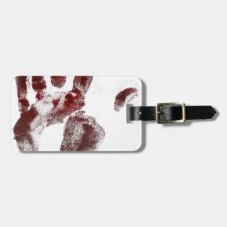 Serial killer blood handprint luggage tag