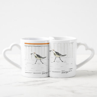Set of cups with bird design.
