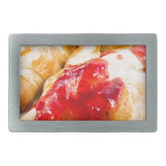 Several croissants with strawberry jam belt buckles