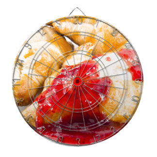 Several croissants with strawberry jam dartboard