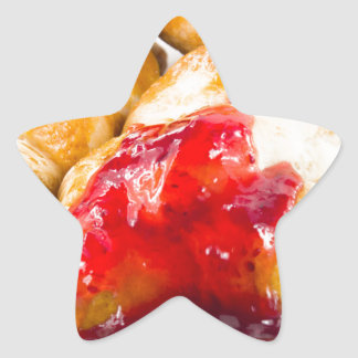 Several croissants with strawberry jam star sticker