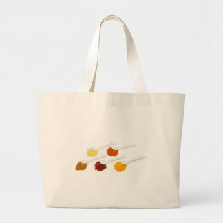 Several seasoning spices on porcelain spoons large tote bag