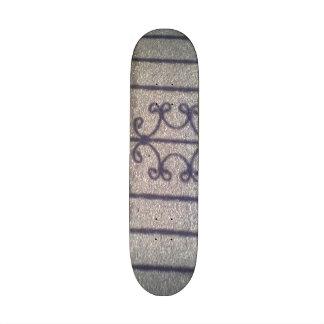 Shadow and asphalt skateboard deck