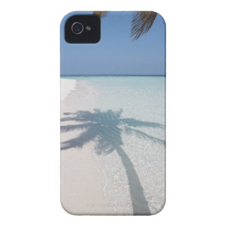 Shadow of a palm tree on a deserted island beach iPhone 4 case