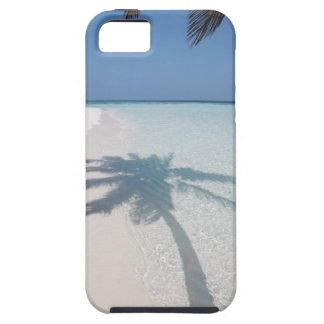 Shadow of a palm tree on a deserted island beach iPhone 5 cases