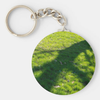 Shadow of the tree at the spring grass basic round button keychain