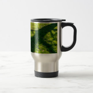 Shadow of the tree at the spring grass travel mug