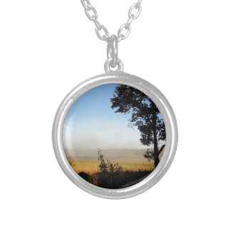Shadows fade to day and fog receeds silver plated necklace