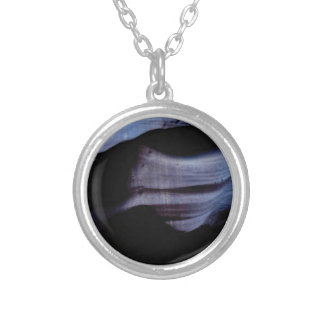 shadows in the rock wall silver plated necklace