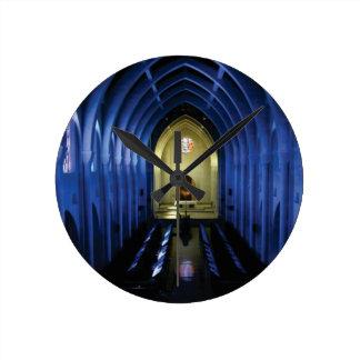 shadows of the dark blue church round clock