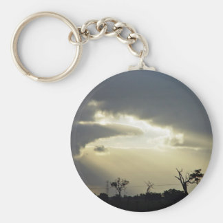 Shafts of sunlight through clouds keychain