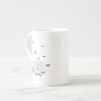 Sheep with flowers and butterflies Z1mk7 Tea Cup