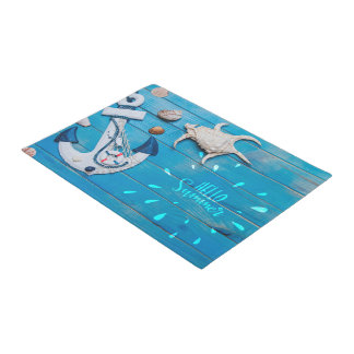Shells and anchor on blue wooden surface Door Mat