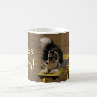 Sheltie Hanging On an Agility Teeter Coffee Mug