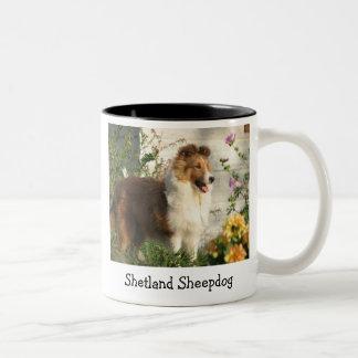 Sheltie standing in flowers mug