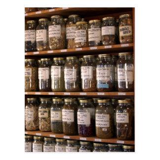 Shelves of herb jars postcard